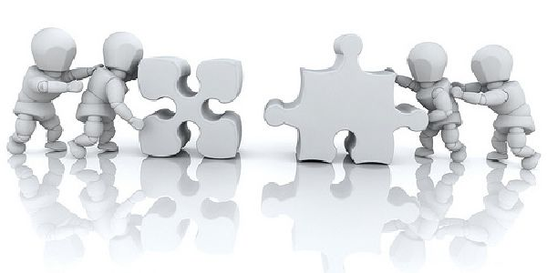 Image of people figures solving a puzzle together